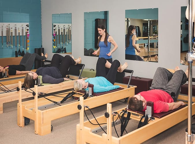Pilates group reformer class taught at St. Paul Pilates Studio